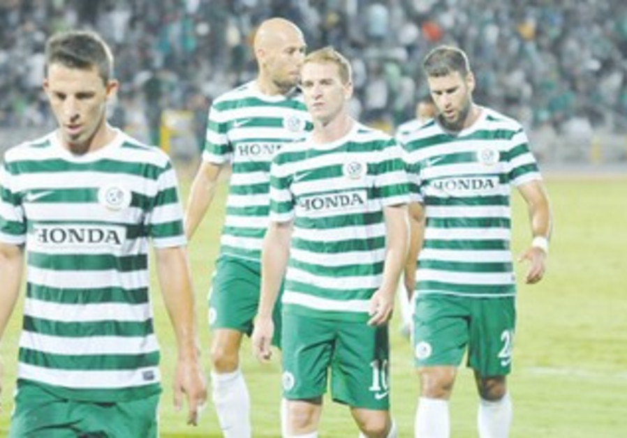 MACCABI HAIFA players left the pitch with their heads hanging low following their 3-0 loss to Mac TA