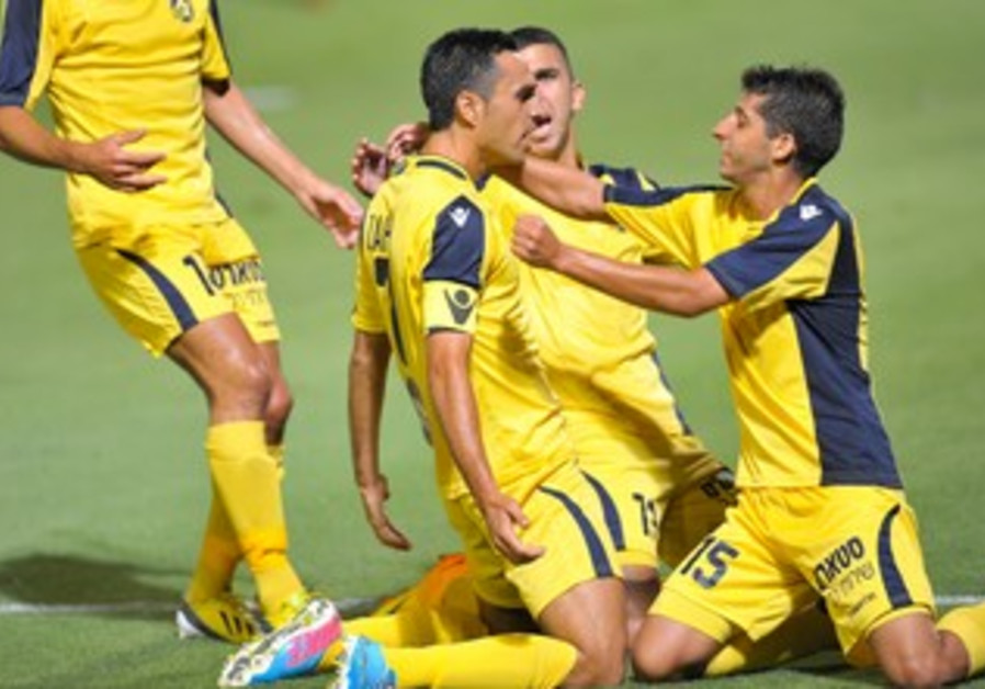 MACCABI TEL AVIV players celebrate.