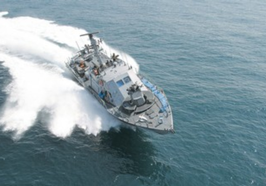 A SUPER DVORA Mark III fast patrol boat races on the Mediterranean Sea.