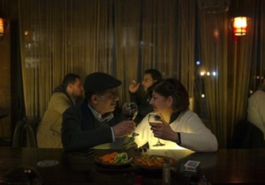A Palestinian couple sits at the bar of a restaurant in the West Bank city of Ramallah.