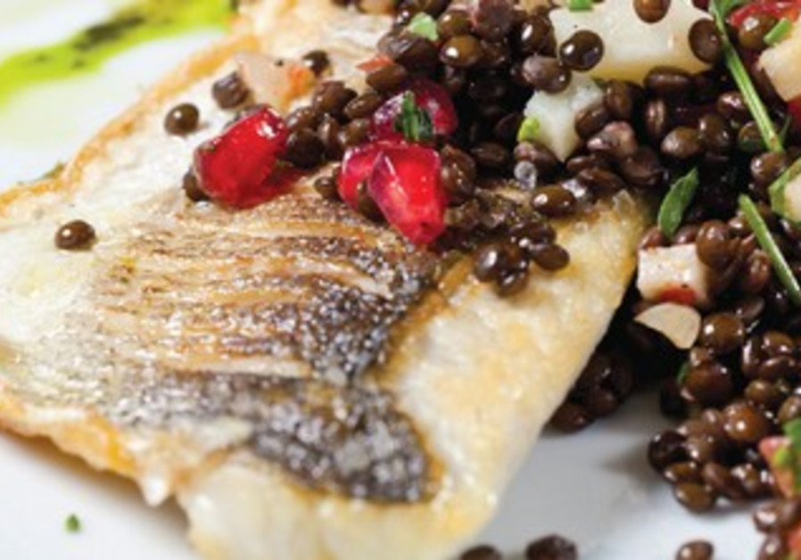 Seared fish with lentil salad, herbs, pomegranate and quince.