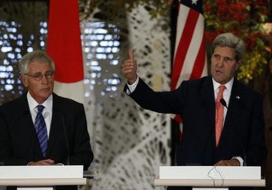 US Secretary of State John Kerry (R) and US Secretary of Defense Chuck Hagel (L) in Tokyo,
