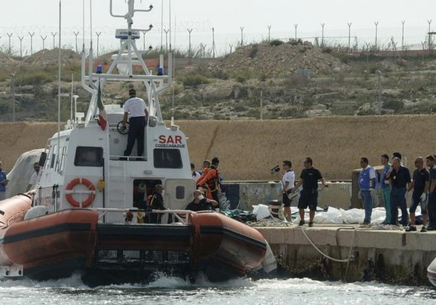 An Italian coastguard vessel after unloading body bags containing African migrants
