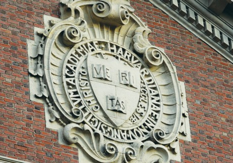 A seal hangs over a building at Harvard University in Cambridge, Massachusetts
