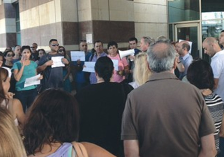 DISGRUNTLED TEACHERS assemble outside the Education Ministry's offices in Tel Aviv