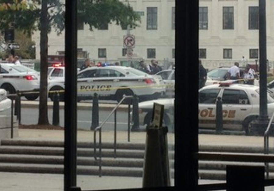 Law enforcement vehicles converge on the scene of a shooting outside US Capitol building, October 3