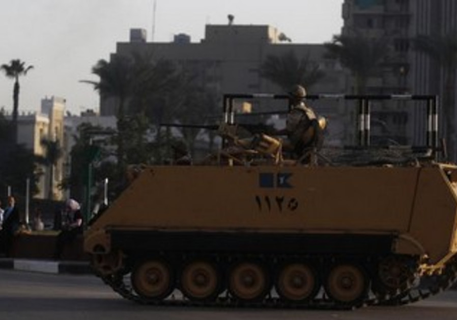 An Egyptian armored personnel carrier on alert in Cairo