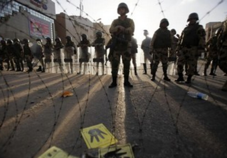 Egyptian soldiers stand guard near Rabaa al-Adawiya square on October 4, 2013.