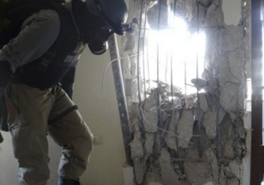 A UN chemical weapons expert, inspects the site of an alleged chemical weapons attack in Syria.