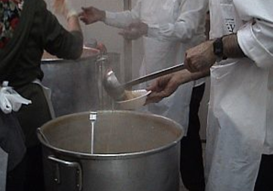 doling out soup food at soup kitchen 298