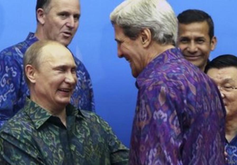 Russia's President Vladimir Putin (L) shakes hands with U.S. Secretary of State John Kerry