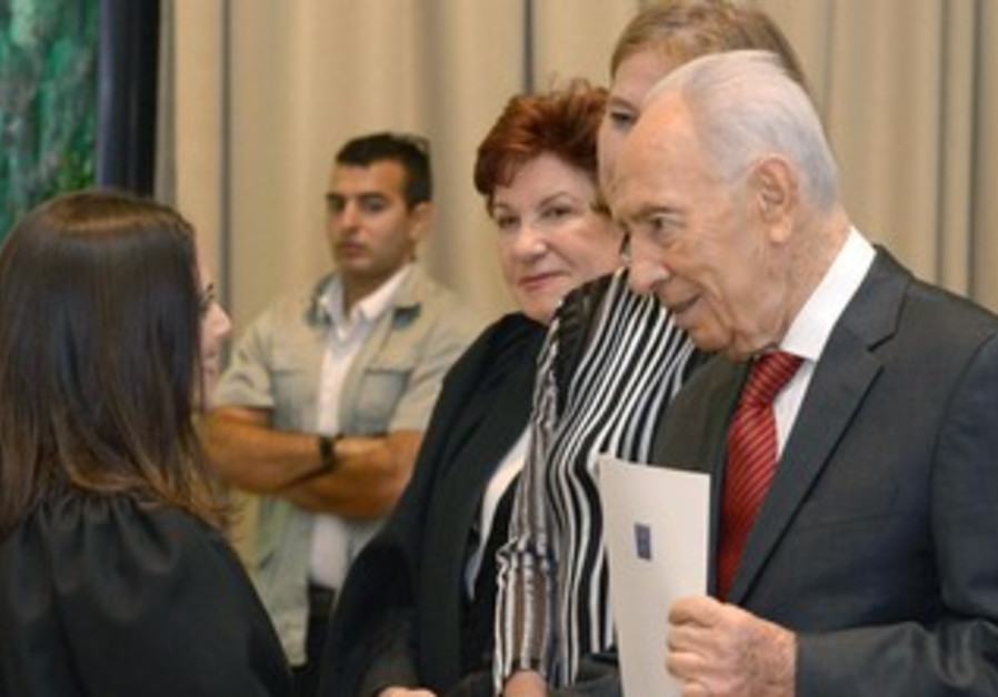 Peres at judge's swearing in ceremony.
