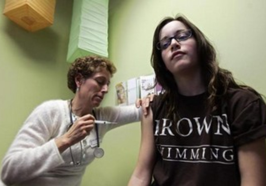 A registered nurse administers a shot of gardasil, a Human Papillomavirus vaccine.