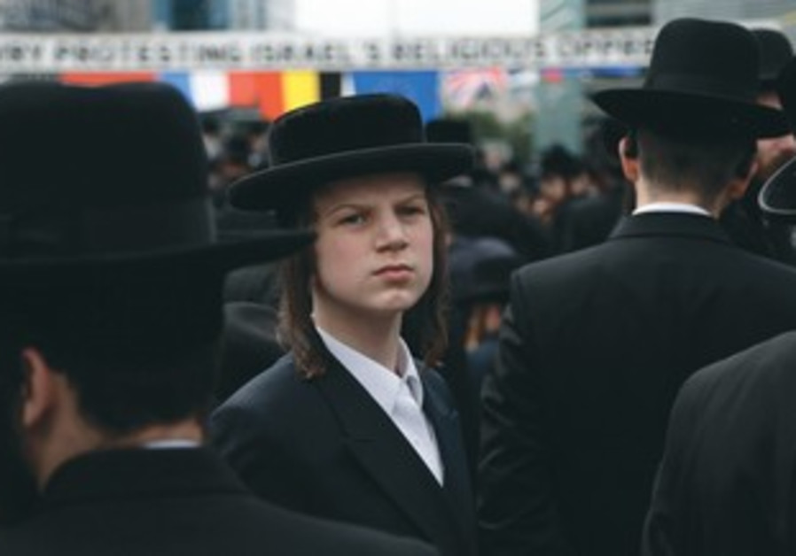 An Orthodox boy takes part in a protest outside the European Union Council building in Brussels.