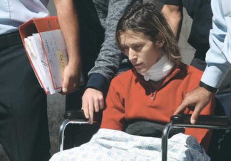 CARINA BRILL is wheeled to her arraignment in Jerusalem. October 9, 2013