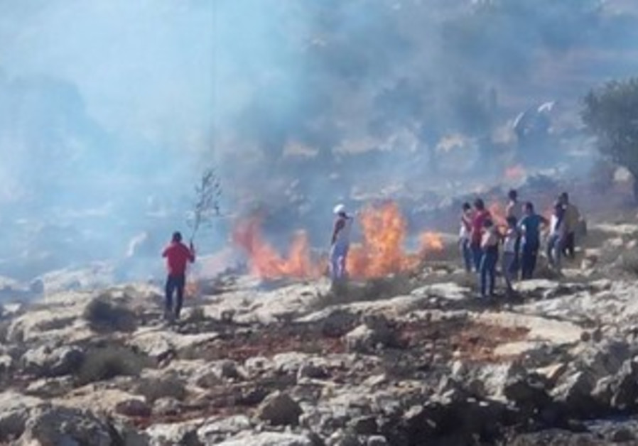 Fire near West Bank village of Jalud allegedly set by settlers in price tag attack, Oct 9, 2013
