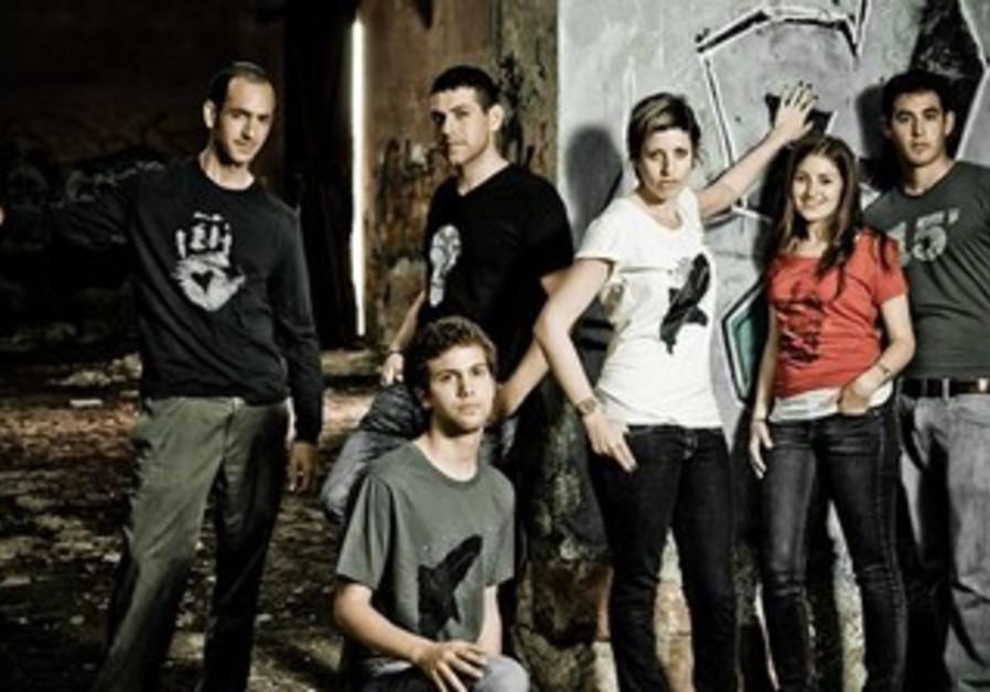 David Kramer (extreme left) owner of NU T-shirts