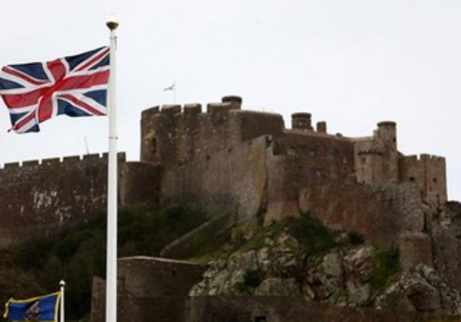 Union Jack flies over Mount Orgueil Castle, the island of Jersey.