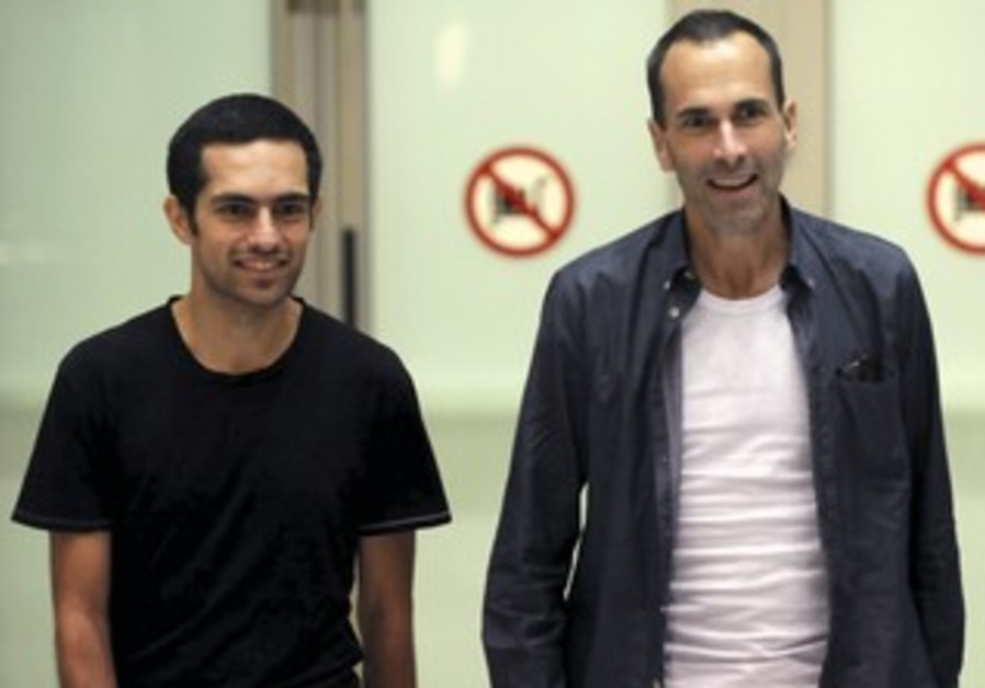 John Greyson (R) and Tarek Loubani arrive in Toronto