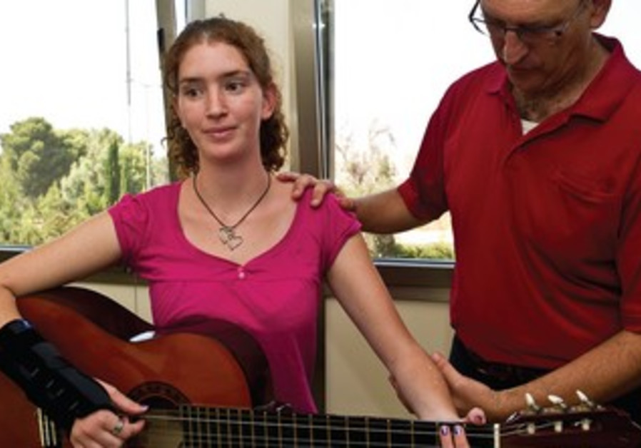 Alan Wallis treats a guitarist suffering from pain.