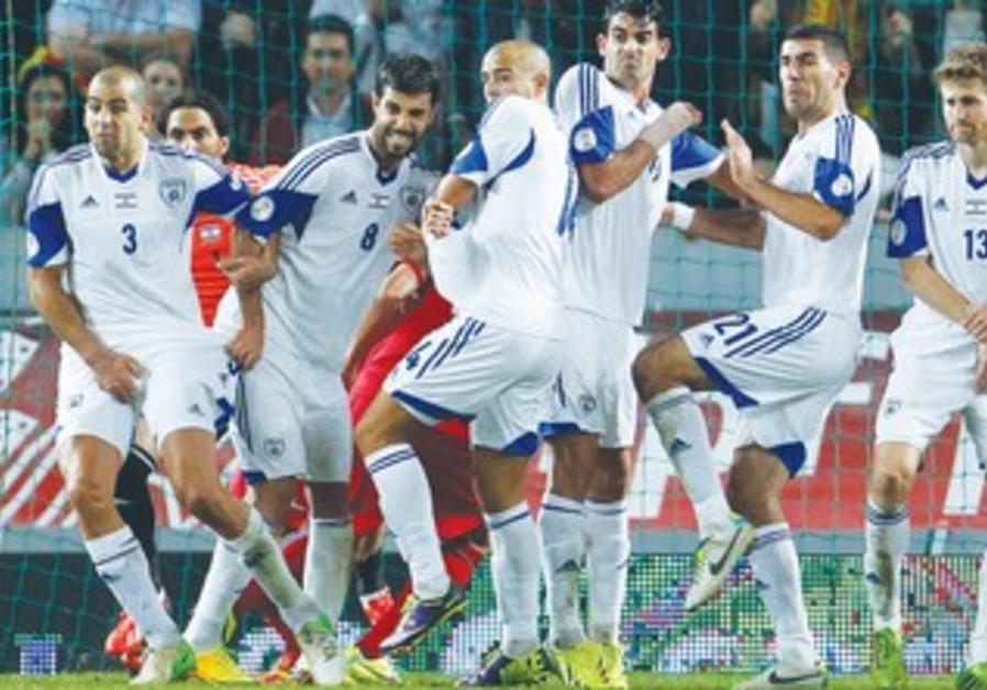 Israel's defense preparing for a free kick against Portugal
