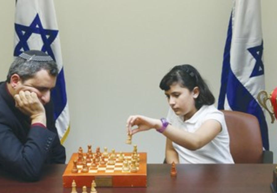 MK ZE'EV ELKIN watches as 10-year-old European Youth Chess Champion Anastasia Vuller makes a move