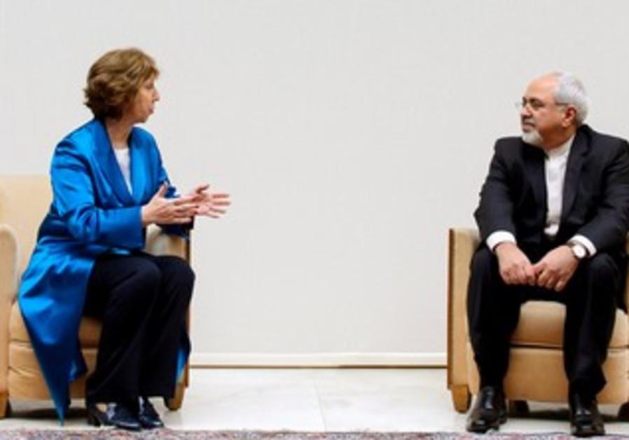 EU's Ashton and Iranian FM Zarif at nuclear talks in Geneva, October 15, 2013