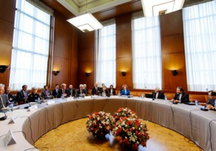 Delegations from Iran, other world powers during closed-door nuclear talks on October 15, 2013.