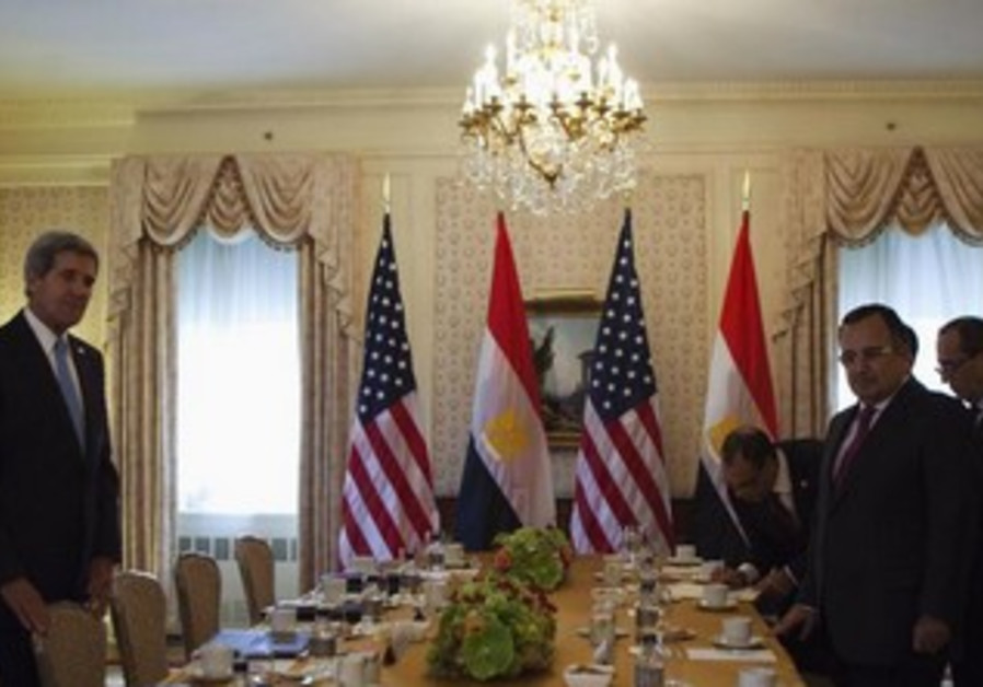 Egypt's FM Nabil Fahmy (2nd R) with US Secretary of State John Kerry, September 22, 2013.