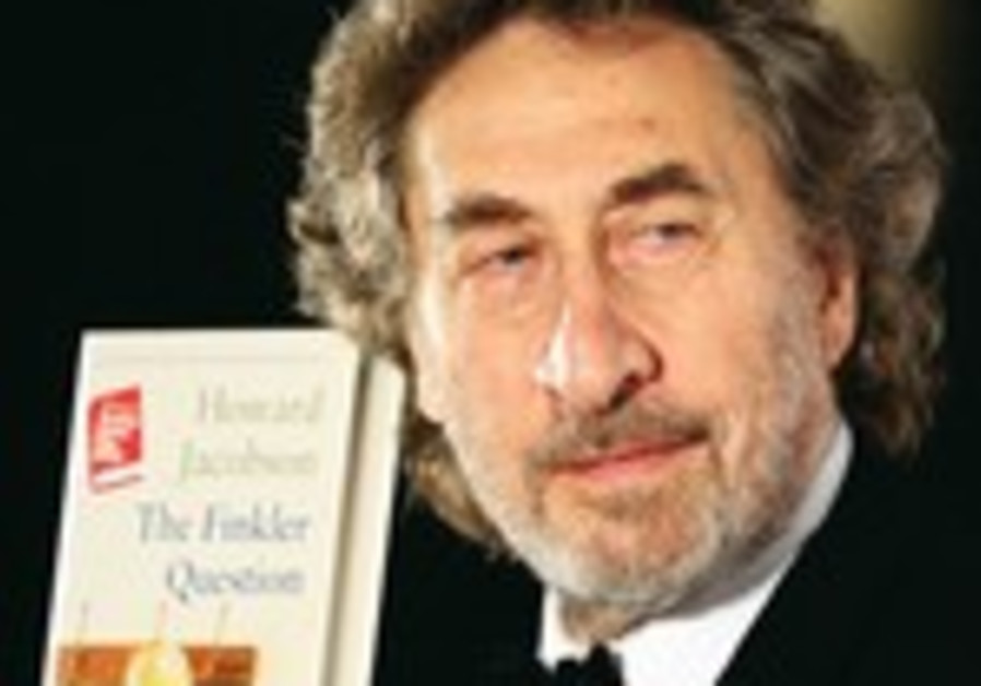 Howard Jacobson holds a copy of his book, 'The Finkler Question'.