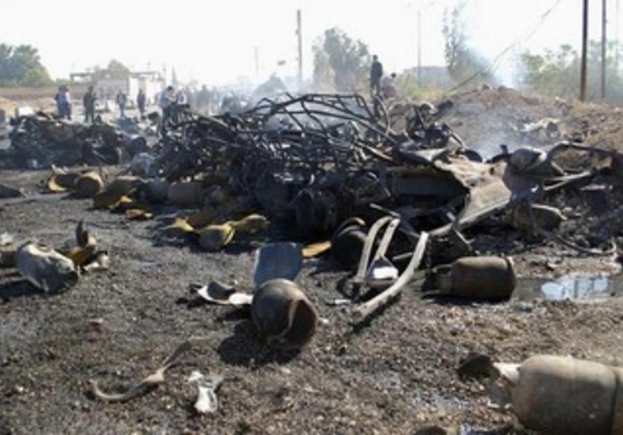 Debris from suicide bombing in Hama, Syria, October 20, 2013.