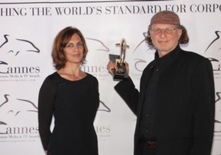 GOLD DOLPHIN winner Simcha Jacobovici poses with his wife Nicole.