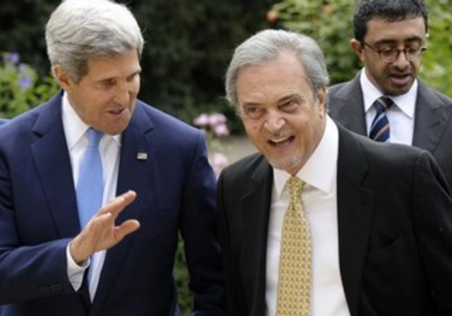 US Sec. of State John Kerry and Saudi FM Saud al Faisal