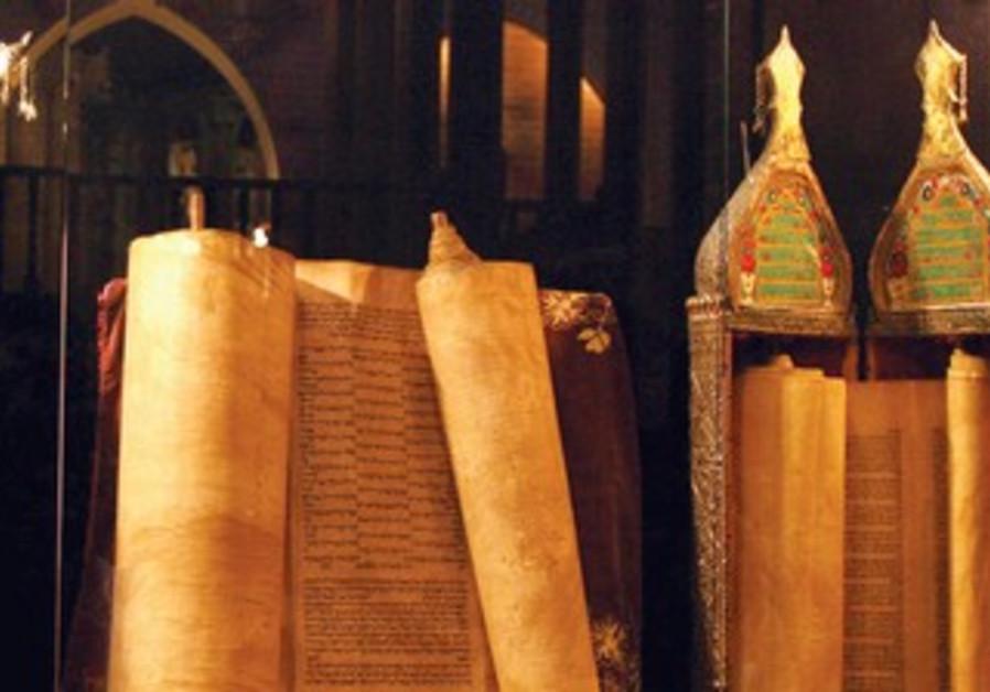 TORAH SCROLLS from the Iraqi Jewish community on display at the Babylonian Jewish Heritage Center