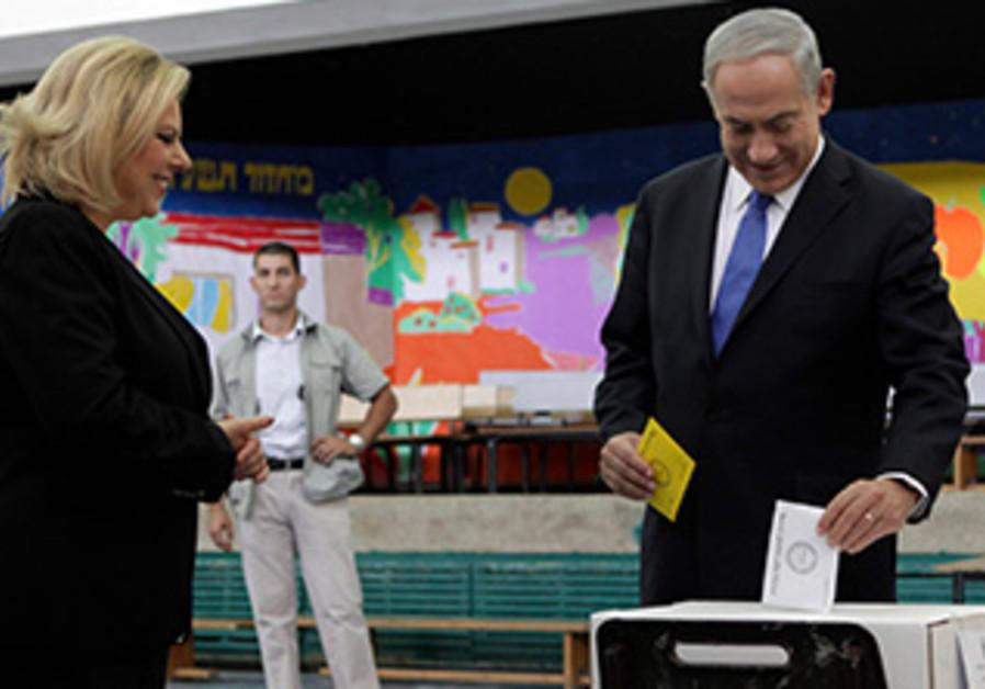 PM Binyamin Netanyahu votes in Jerusalem's municipal elections, October 22, 2013.