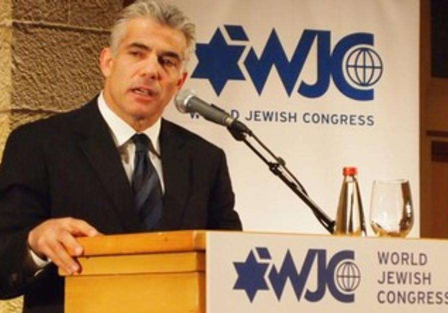 Yair Lapid addresses WJC conference in Jerusalem, October 21, 2013