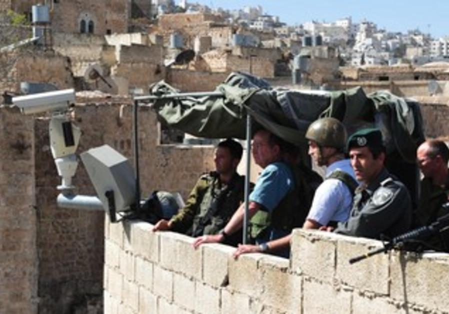 Defense Minister Moshe Ya'alon on tour of Hebron, October 22, 2013
