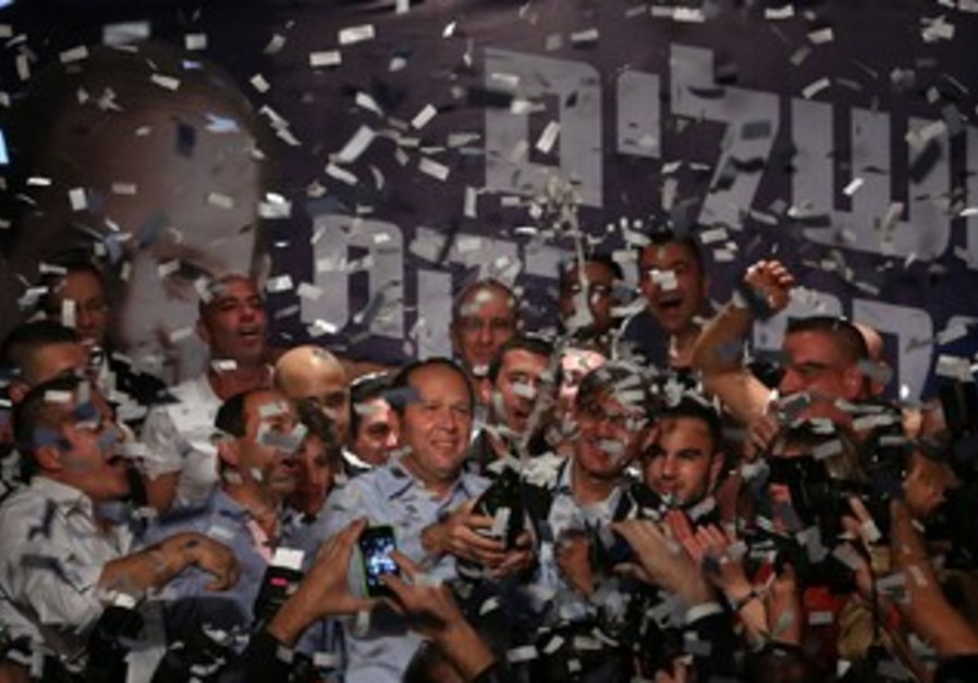 Incumbent Jerusalem Mayor Nir Barkat celebrate his victory in municipal election, October 23, 2013.