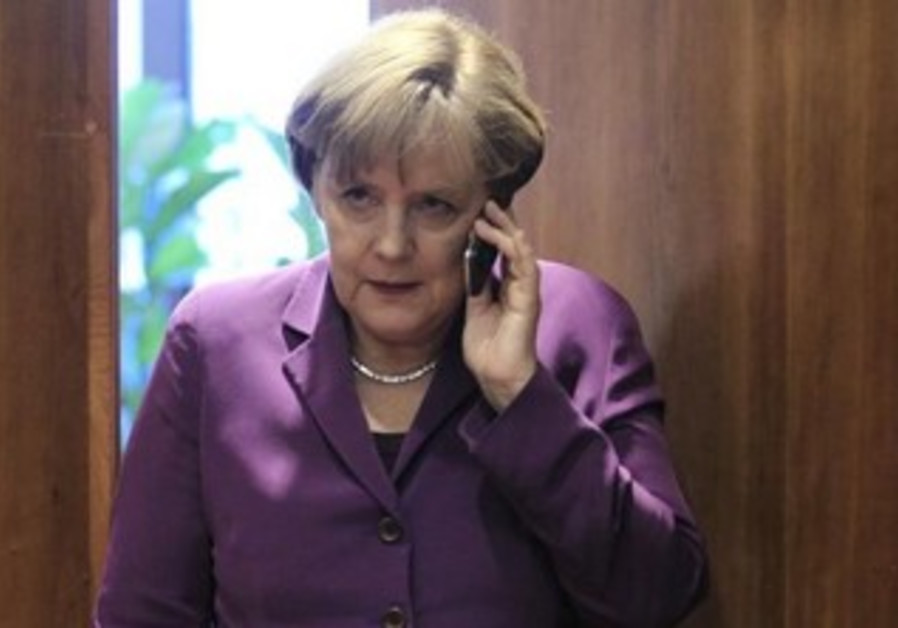 Germany's Chancellor Angela Merkel uses her mobile phone [file].