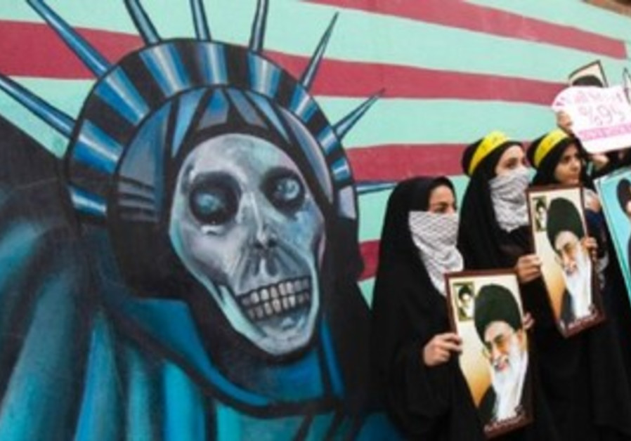 Iranian students stand in front of former US embassy in Tehran, November 4, 2011.