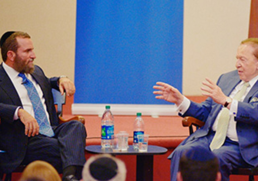 Rabbi Shmuley Boteach and Sheldon Adelson at a Yeshiva University debate, October 22, 2013.