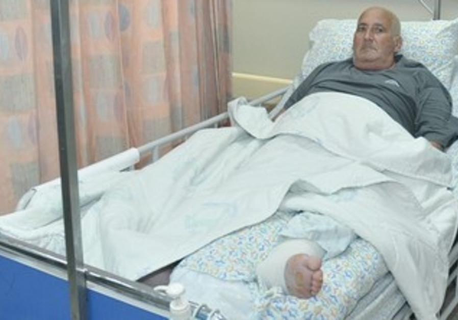 Shlomo Lankri in his bed at Emek Medical Center