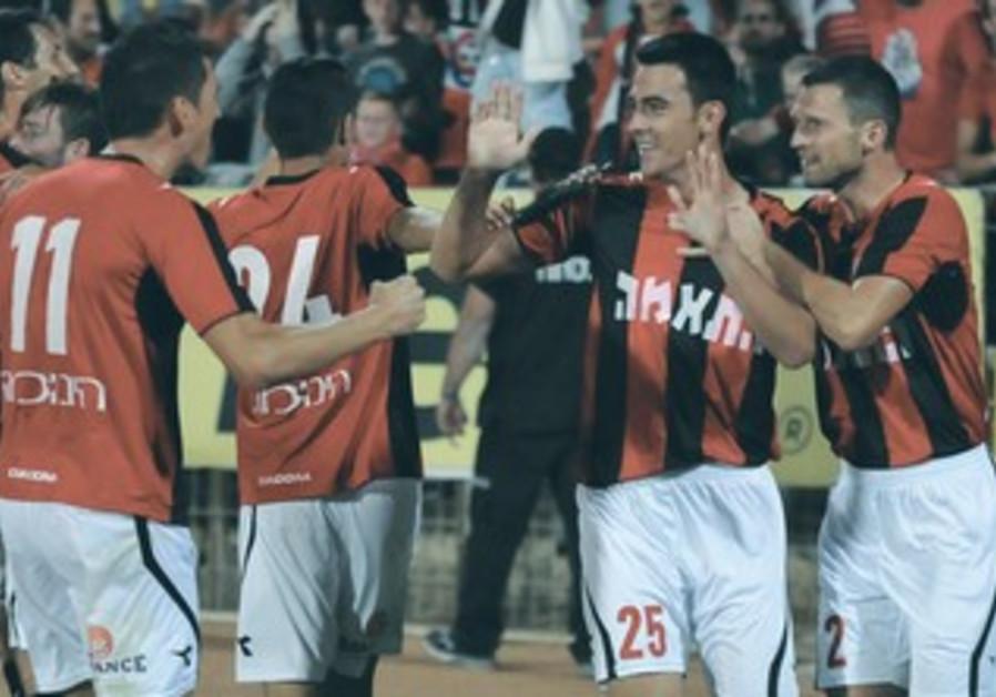 Hapoel Haifa players celebrate victory over Maccabi