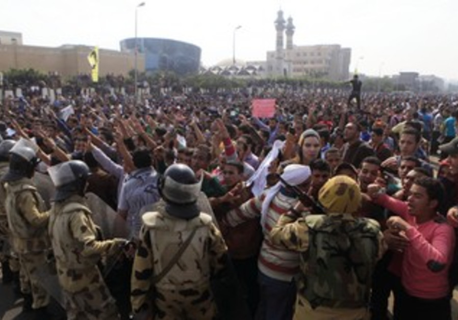 AL-AZHAR UNIVERSITY students shout slogans against the military and the Interior Ministry