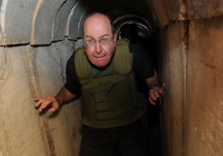 Defense Minister Moshe Ya'alon views a Hamas tunnel on October 29, 2013.