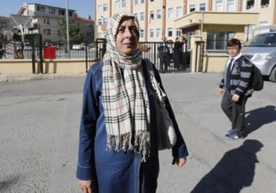 A high-school teacher in Ankara who for years had to remove her head scarf at work.