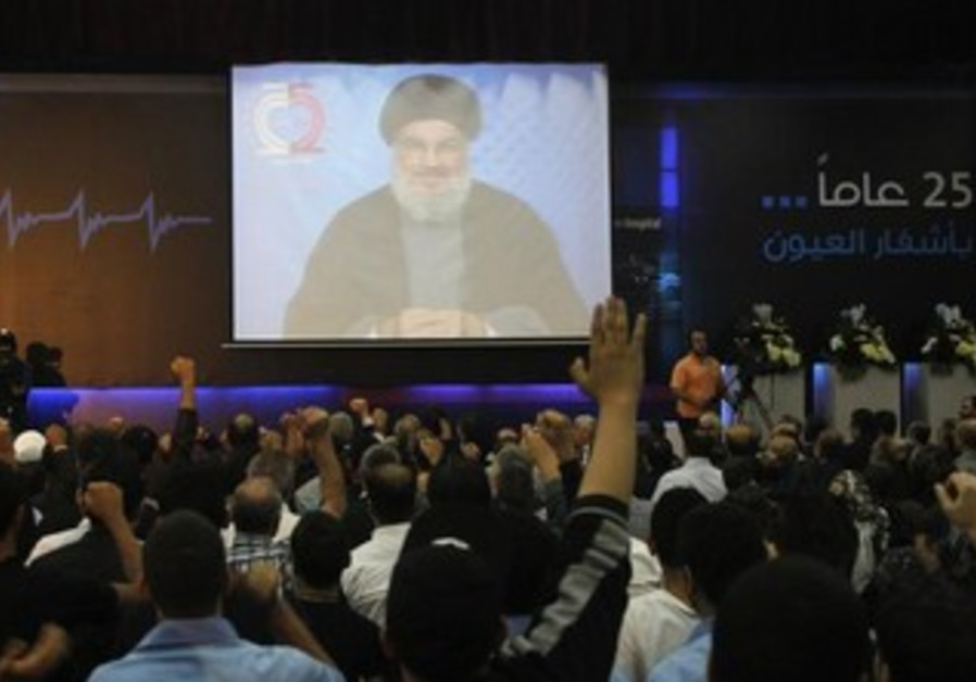 Hezbollah supporters gesture as they listen to Nasrallah on October 29, 2013.