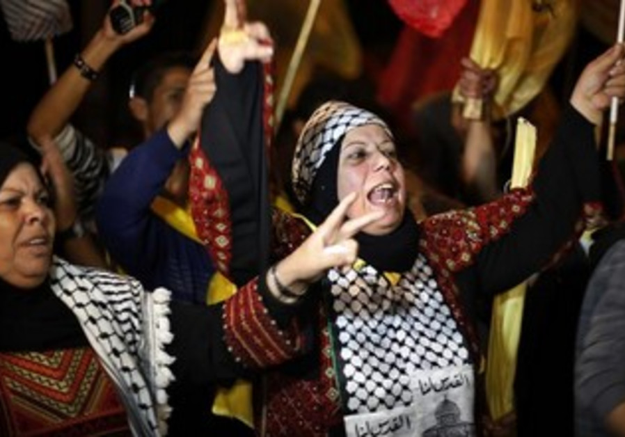 Palestinian women celebrate as they wait for the release of prisoners from Israeli jails in Gaza.