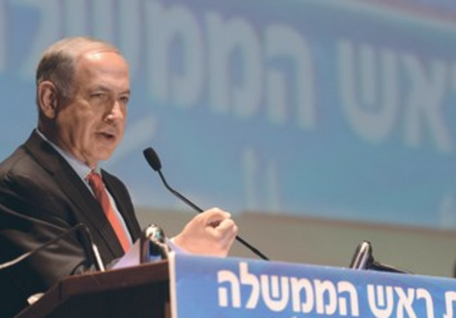 Prime Minister Binyamin Netanyahu speaks yesterday in Tel Aviv at the conference on economic issues.