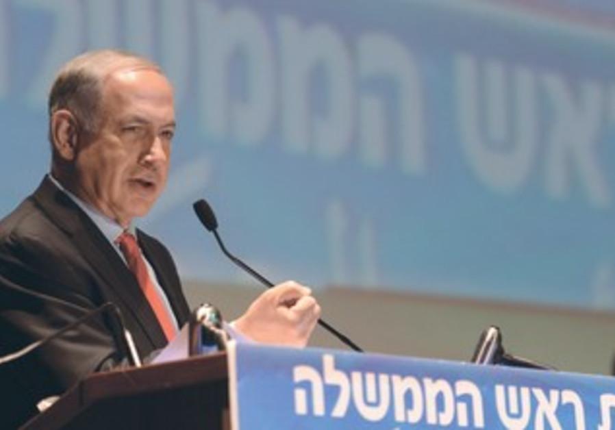 Prime Minister Binyamin Netanyahu speaks yesterday in Tel Aviv at the conference on economic issues.